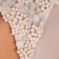 close up of beading detail -